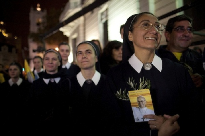 Nuns watch Pope Francis' installation Mass on a big screen outside the Metropolitan Cathedral in Buenos Aires, Argentina, Tuesday, March 19, 2013. Argentine's former cardinal Jorge Mario Bergoglio was chosen as leader of the Catholic Church on March 13. (AP Photo/Natacha Pisarenko)