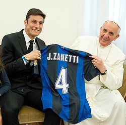 Pope Francis receives a soccer jersey from Inter Milan captain Javier Zanetti's during a private audience at the Vatican April 25. (CNS photo/L'Ossevatore Romano via Reuters) (April 26, 2013)