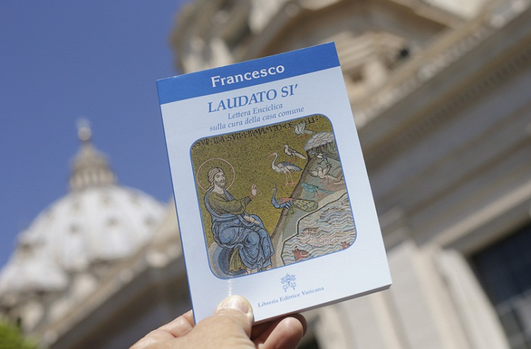 "Pope Francis' new encyclical titled ""Laudato Si (Be Praised), On the Care of Our Common Home"", is displayed during the presentation news conference at the Vatican"