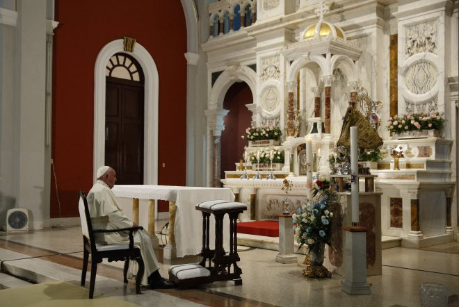 Pope Francis prays near the statue of Our Lady of Charity, patroness of Cuba, in El Cobre