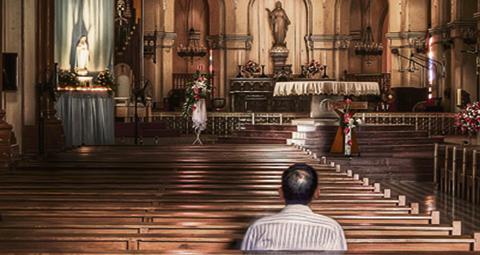 9-MAN-PRAYING-IN-CHURCH