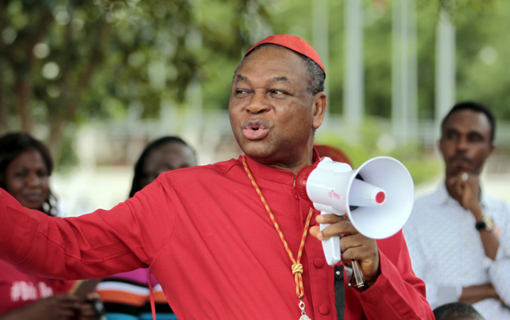 Catholic Archbishop of Abuja John Onaiyekan addresses Bring Back Our Girls (BBOG) campaigners during a protest procession marking the 500th day since the abduction of girls in Chibok, along a road in Abuja