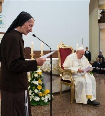 pope_francis_listens_as_85_year_old_sister_maria_kaleta_speaks_in_tiranas_st_paul_cathedral_albania_sunday_sept_21_2014_credit__losservatore_romano_92514_cna